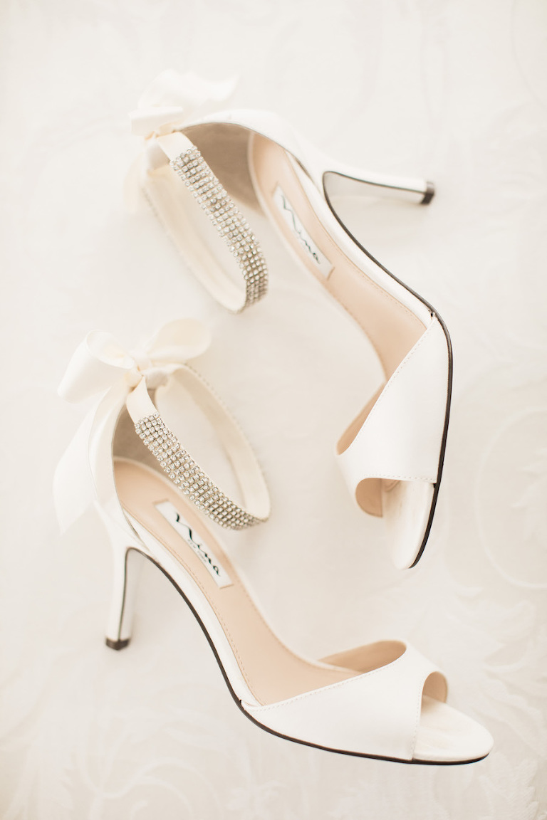 Ivory Peep Toe Open Toe Satin Wedding Shoes with Rhinestone Ankle Strap and Bow | Nina Vinnie Style Pump
