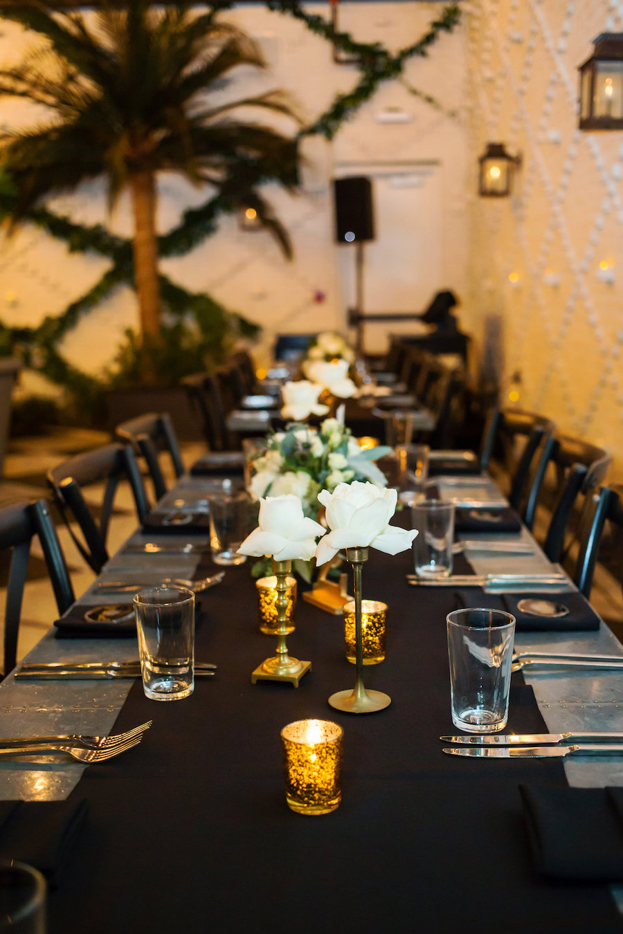 Vintage Inspired Wedding Reception with Black, Gold and Ivory Centerpieces on Long Feasting Tables