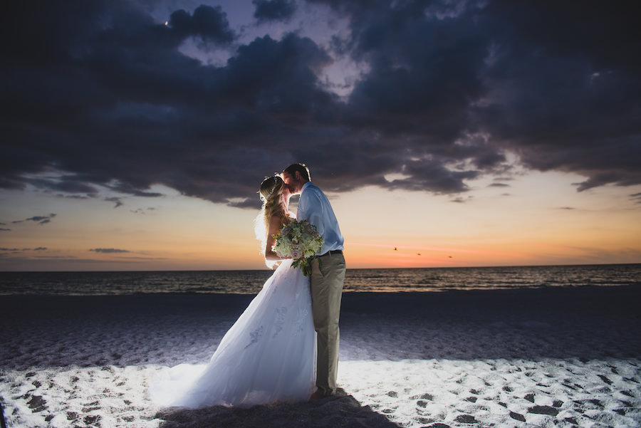 Sunset Bride and Groom Wedding Portrait in Ivory Wedding Dress with Tulle and Embroidery with Beachy Wedding Hair with Crystal Headband and Groom in Khaki Pants | Tampa Wedding Hair and Makeup Artist Michele Renee The Studio | Tampa Wedding Photographer Kera Photography