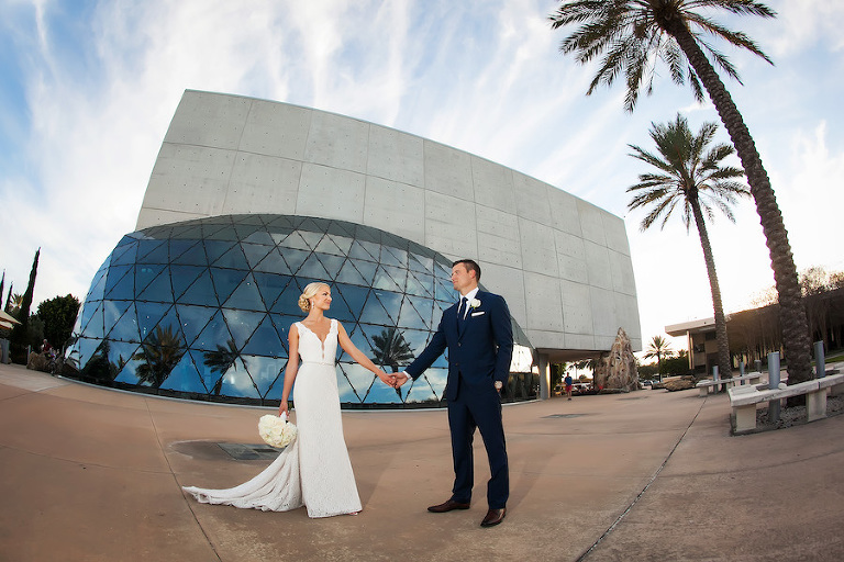 St. Pete Bride and Groom Wedding Portrait in Navy Blue Suit and Ivory Mikaella Wedding Dress | Downtown St. Pete Wedding Venue Dali Musuem | Photographer Limelight Photography | Wedding Planner Exquisite Events