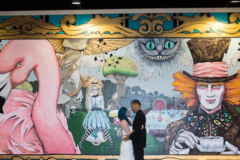 Alice in Wonderland Graffiti Art Mural Wedding Portrait in Downtown St. Pete | Whimsical Fairytale Wedding Inspiration| St. Petersburg Wedding Planner UNIQUE Weddings & Events