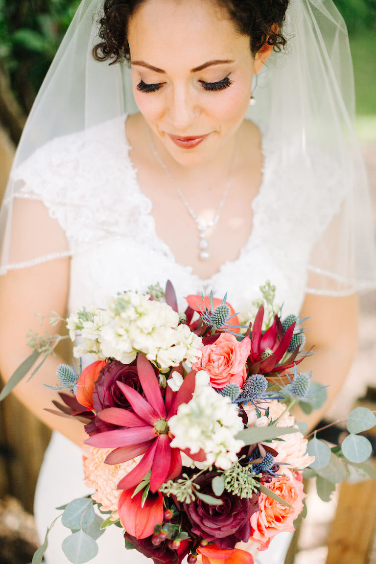 Bridal Wedding Portrait in White, Lace Wedding Dress with Veil and Deep Burgundy Red Wedding Bouquet