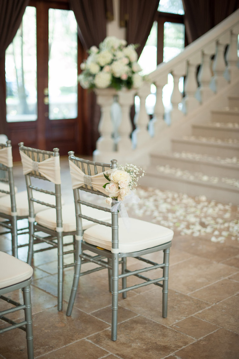 Indoor, Private Residence Wedding Ceremony with Silver Chiavari Chairs and Ivory Flower Petals