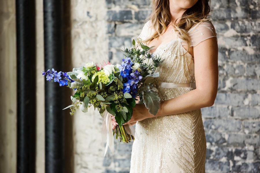 Bridal Wedding Portrait in Beaded Ivory Jenny Packham Wedding Dress with Ivory and Blue Wedding Bouquet with Greenery
