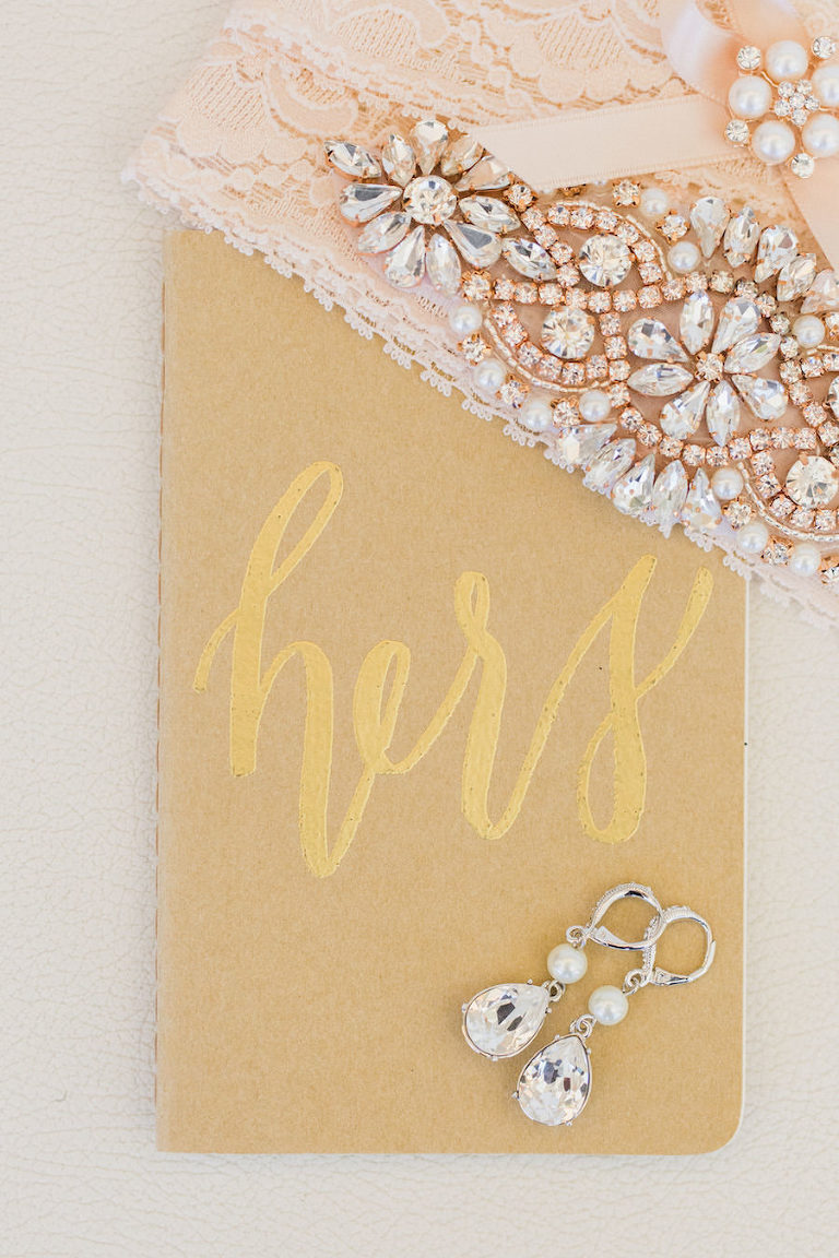 Blush and gold wedding accessories | crystal and pearl bridal earrings | garter | vow book