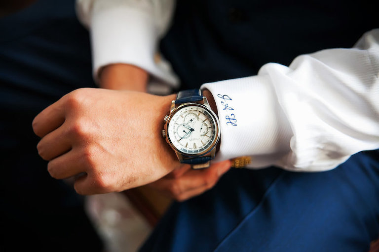 Groom in Navy Blue and White Monogrammed Suit and Navy Watch