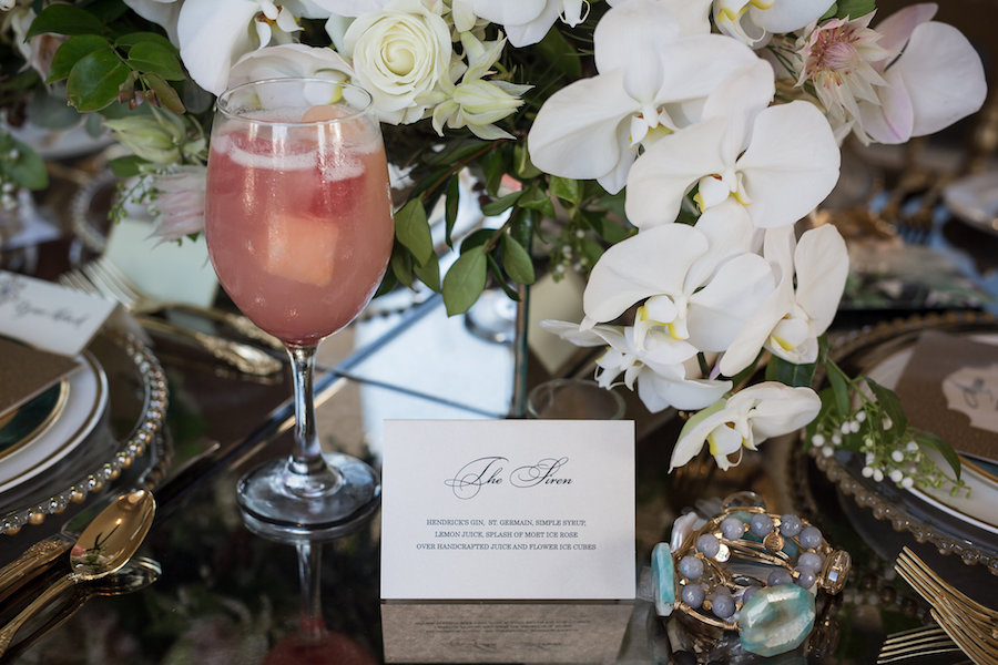 Outdoor Elegant, Sophisticated Vintage Wedding Reception Ideas & Inspiration with Beaded Chargers and White Floral Centerpieces and Pink Signature Drink | Sarasota Wedding Planner NK Productions | Waterfront Luxury Hotel Wedding Venue Ritz Carlton Sarasota