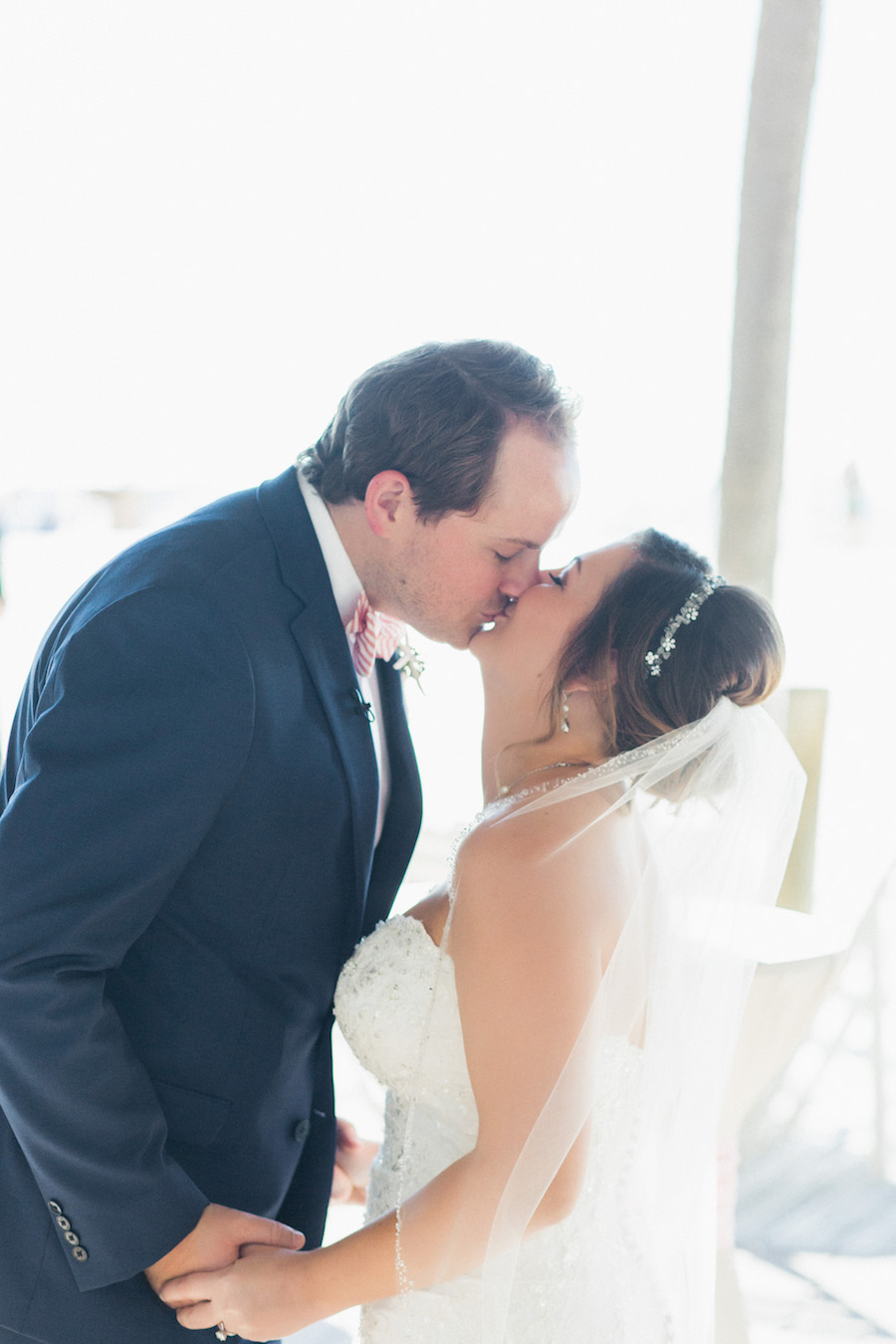 Outdoor Clearwater Beach bride and groom First look wedding portrait | Bride and groom kissing