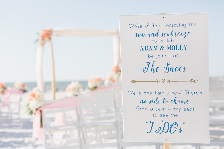 Florida beach wedding ceremony decor | Beach-themed ceremony sign | Blush and ivory ceremony flowers | Hilton Clearwater Beach