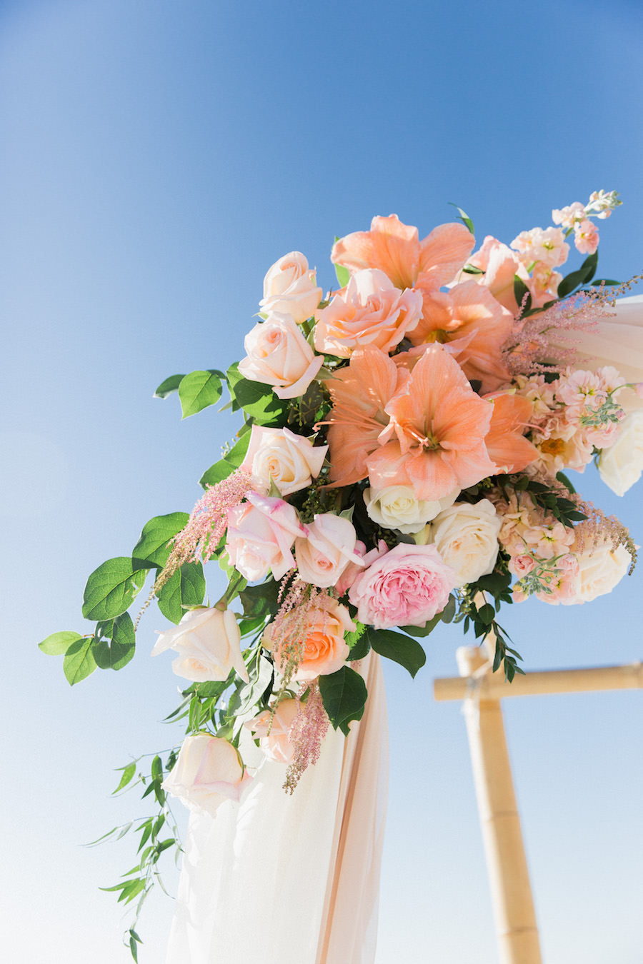 Peach, blush, ivory and green wedding ceremony florals on Bamboo Altar | Florida Clearwater beach wedding Decor Ideas and Inspiration