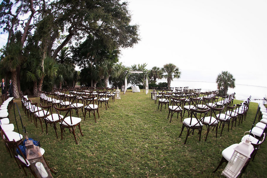 Outdoor Sarasota Wedding Ceremony with Brown and White Chairs, Lanterns and Arch   Tampa Bay Wedding Photographer Limelight Photography   Tampa Bay Wedding Planner NK Productions