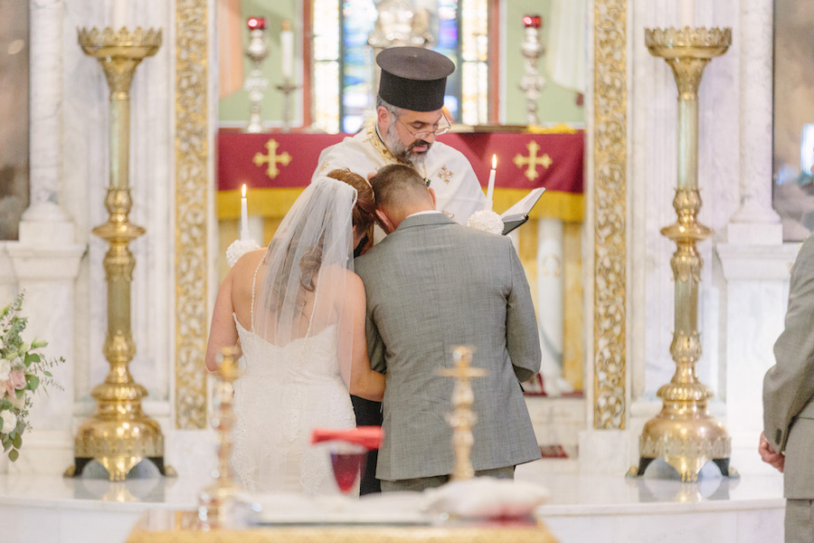 Bride and Groom at Wedding Ceremony Altar Traditional Greek Church Wedding Ceremony St. Nicholas Tarpon Springs