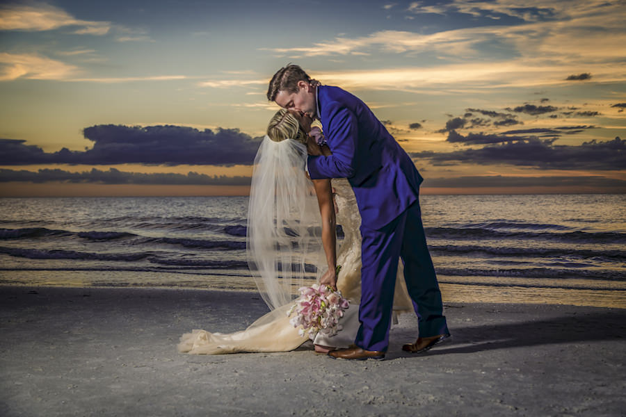 Outdoor, Waterfront Bride and Groom Kiss Wedding Portrait at Sunset   Waterfront Hotel Wedding Venue Hilton Clearwater Beach