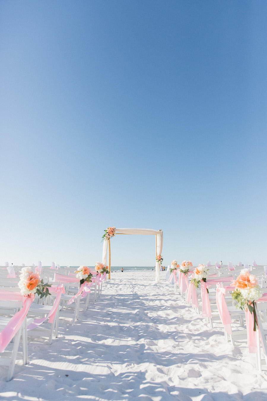 Florida Beach wedding ceremony decor | Blush, ivory and peach ceremony wedding flowers | Tampa Bay Beachfront Hotel Wedding Venue Hilton Clearwater Beach