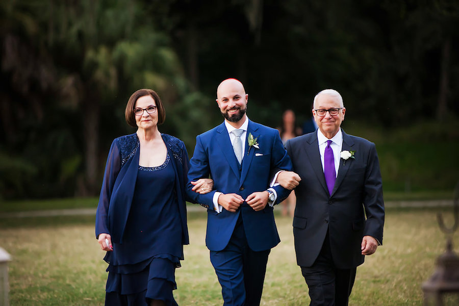 Outdoor Sarasota Groom Walking Down Aisle with his Parents