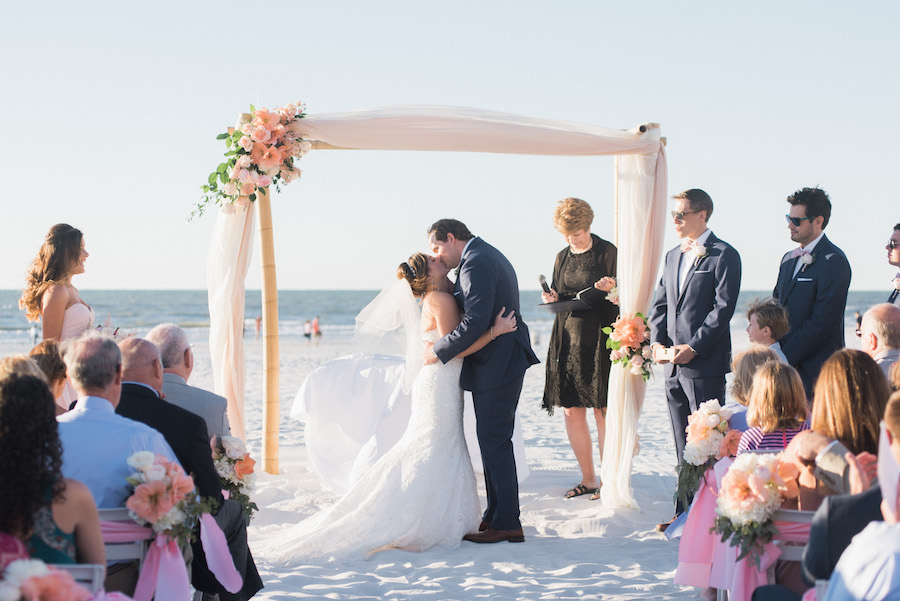 Bride and Groom Ceremony Kiss | Ivory and blush Beach chic wedding Ceremony Decor | Tampa Bay Beachfront Hotel Wedding Venue Hilton Clearwater Beach