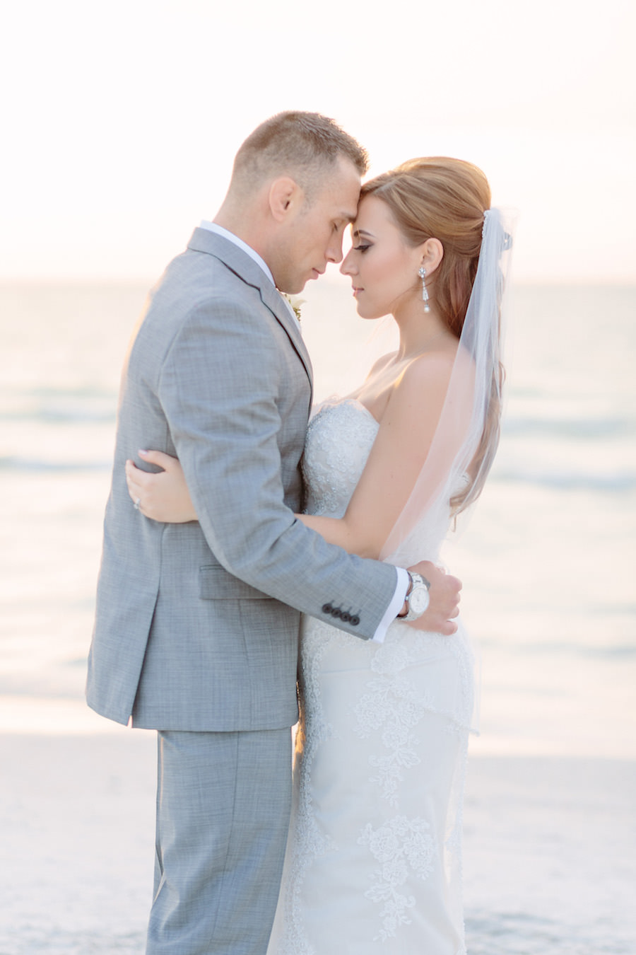Florida Waterfront Bride and Groom Sunset Wedding Portrait   Clearwater Beach Bridal Hair and Makeup by Michele Renee The Studio