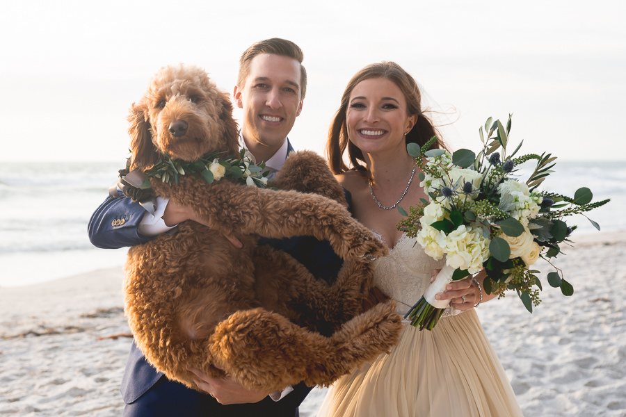 Outdoor, Florida Beach Waterfront Bride and Groom Wedding Portrait with Pet Goldendoodle | St. Petersburg Wedding Photographer Grind and Press Photography