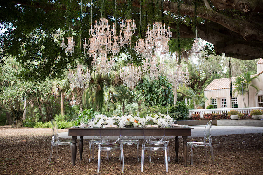 Elegant Garden Party Outdoor Wedding Reception with Chandelier Canopy, Ghost Chairs, Farm Chairs and White Floral Centerpieces | Luxury Sarasota Wedding Venue Marie Selby Gardens | Wedding Planner NK Productions