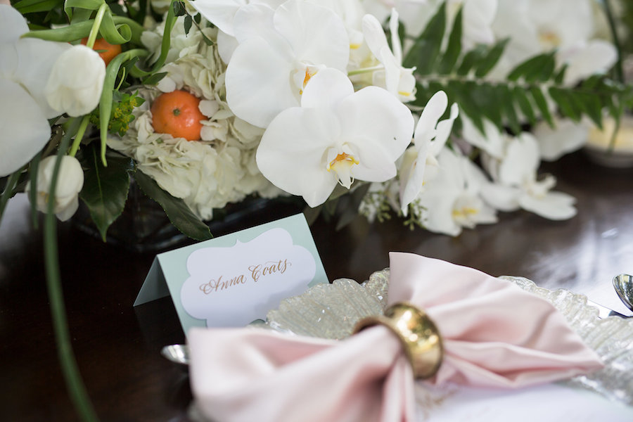 White Orchid Centerpieces with Hydrangea and Mini Orange Centerpieces with Silver Scalloped Chargers and Pink Bow Napkins | Sarasota Wedding Planner NK Productions