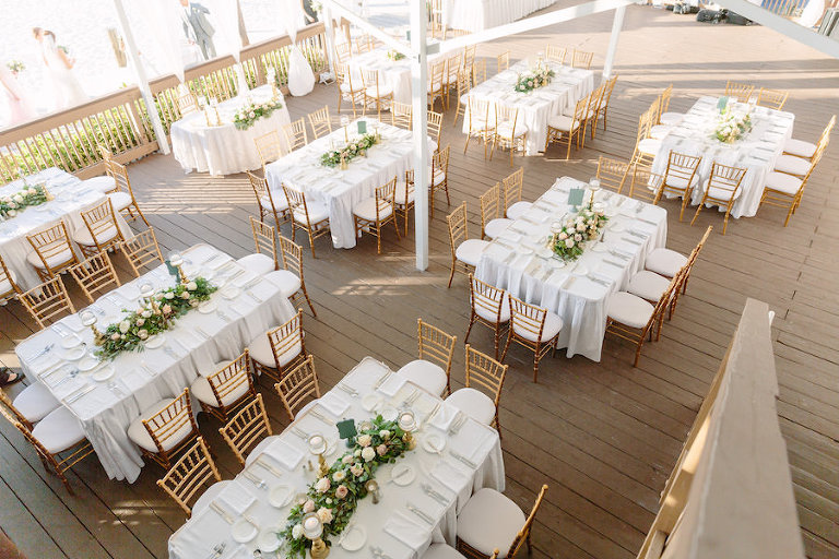 Outdoor Destination Wedding Reception Decor with White Linens, Gold Chiavari Chairs and Ivory and Blush Pink Centerpieces with Greenery | Waterfront Wedding Venue Hilton Clearwater Beach