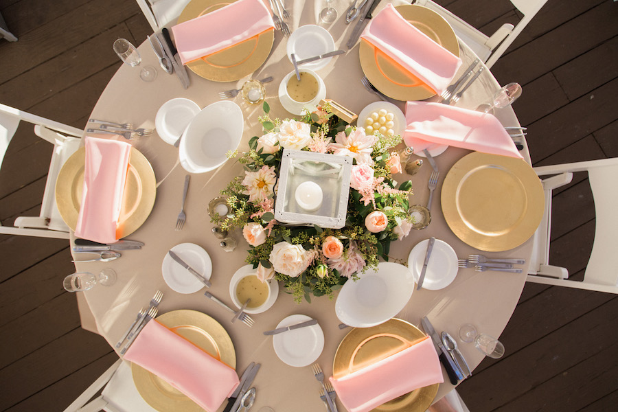 Elegant and Romantic Beach Lantern wedding centerpieces with pink, peach and ivory florals | White candle centerpiece | Pink and white wedding reception decor inspiration and ideas | Florida outdoor wedding reception | Tampa Bay Beachfront Hotel Wedding Venue Hilton Clearwater Beach