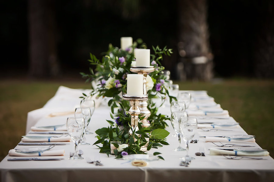 Ivory, Purple and Greenery in Silver Vase with White Candles   Wedding Reception Decor and Inspiration