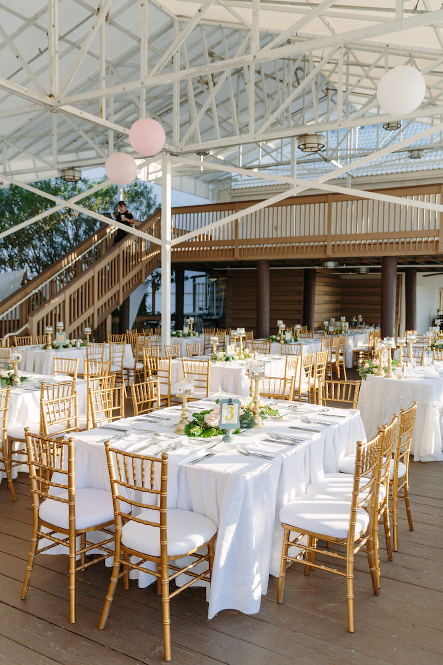 Outdoor Tented Wedding Reception with Gold and Ivory Centerpieces with Greenery and Chiavari Chairs   Clearwater Beach Wedding Venue Hilton Clearwater Beach