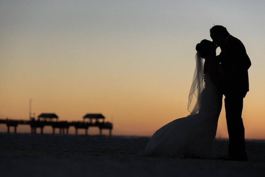 Florida Bride and groom sunset beach wedding portrait with Pier | Tampa Bay Beachfront Hotel Wedding Venue Hilton Clearwater Beach
