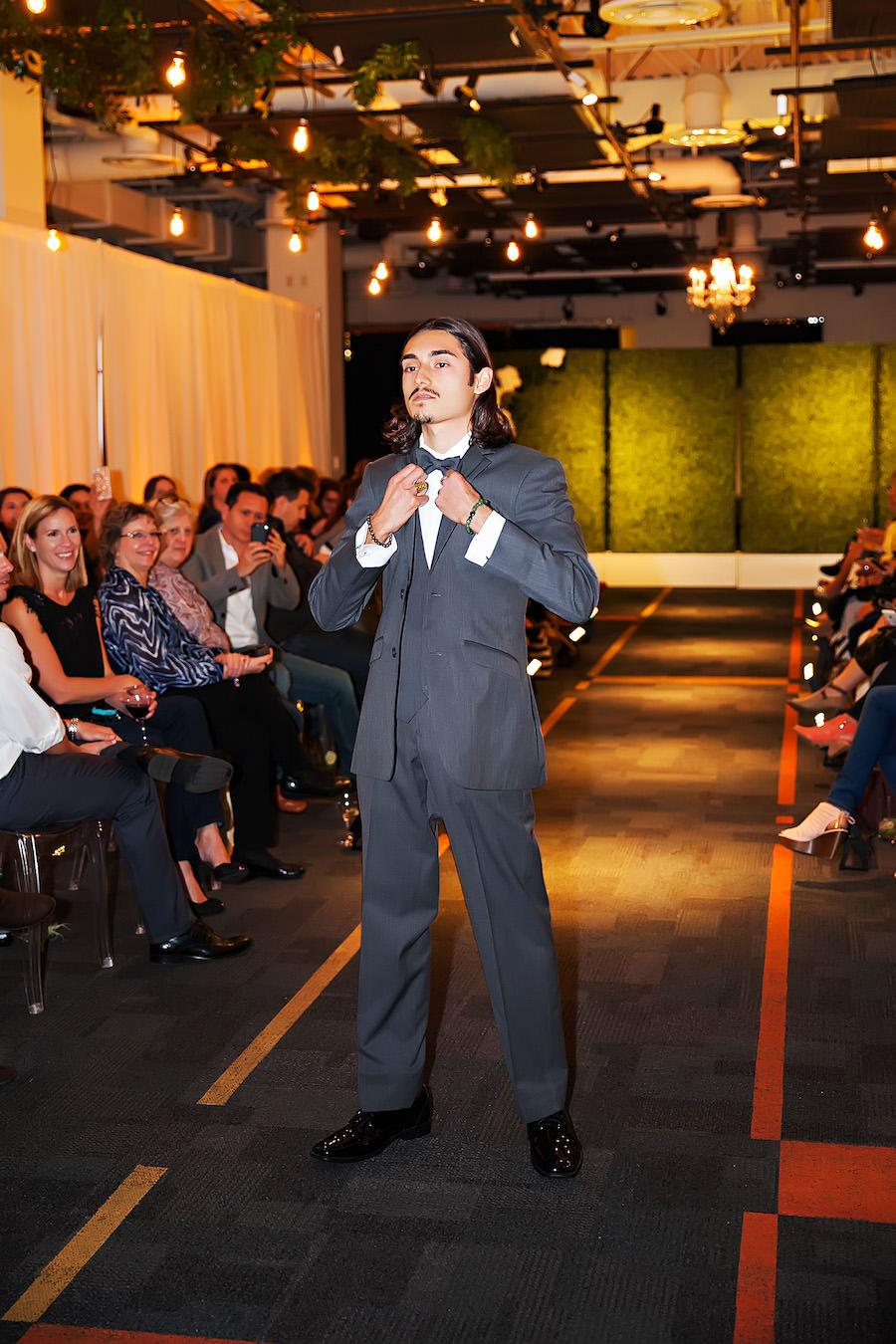 Marry Me Tampa Bay Wedding Week Bridal Fashion Runway Show | Grey Groomsmen Tuxedo Suit | Tampa Bay Wedding Photographer Limelight Photography | Wedding Planner Glitz Events