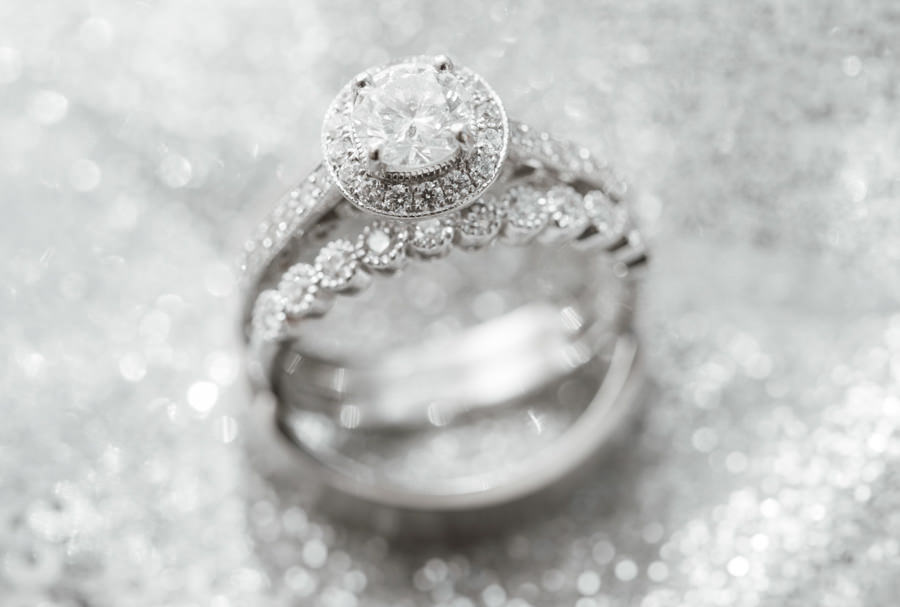 Diamond Bridal Wedding Band and Radiant Cut Engagement Ring Portrait on Silver Sparkly Linen
