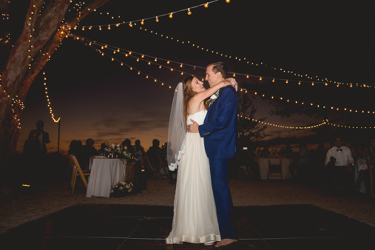 Florida Outdoor, Waterfront Bride and Groom First Dance on Treasure Island | St. Petersburg Wedding Photographer Grind and Press Photography | St Petersburg Wedding Planner Special Moments Event Planning | Cafe Lighting by Nature Coast Event Services