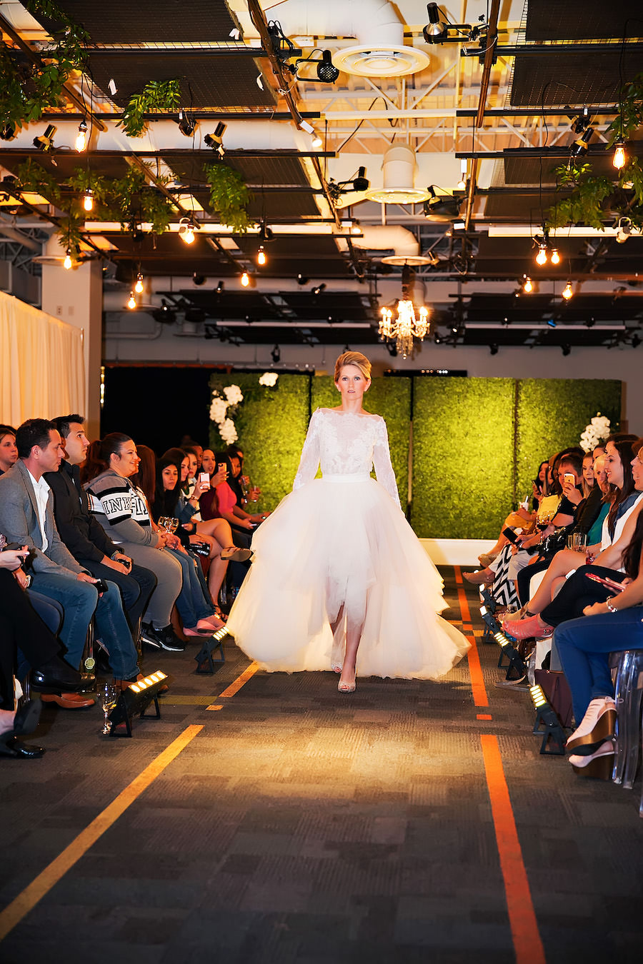 White Lace Alyne Lis High Low Wedding Dress | Marry Me Tampa Bay Wedding Week Bridal Fashion Runway Show | Tampa Bay Wedding Photographer Limelight Photography | Wedding Planner Glitz Events | Hair and Makeup Artist Michele Renee The Studio | Couture Wedding Dress Shop Isabel O'Neil Bridal