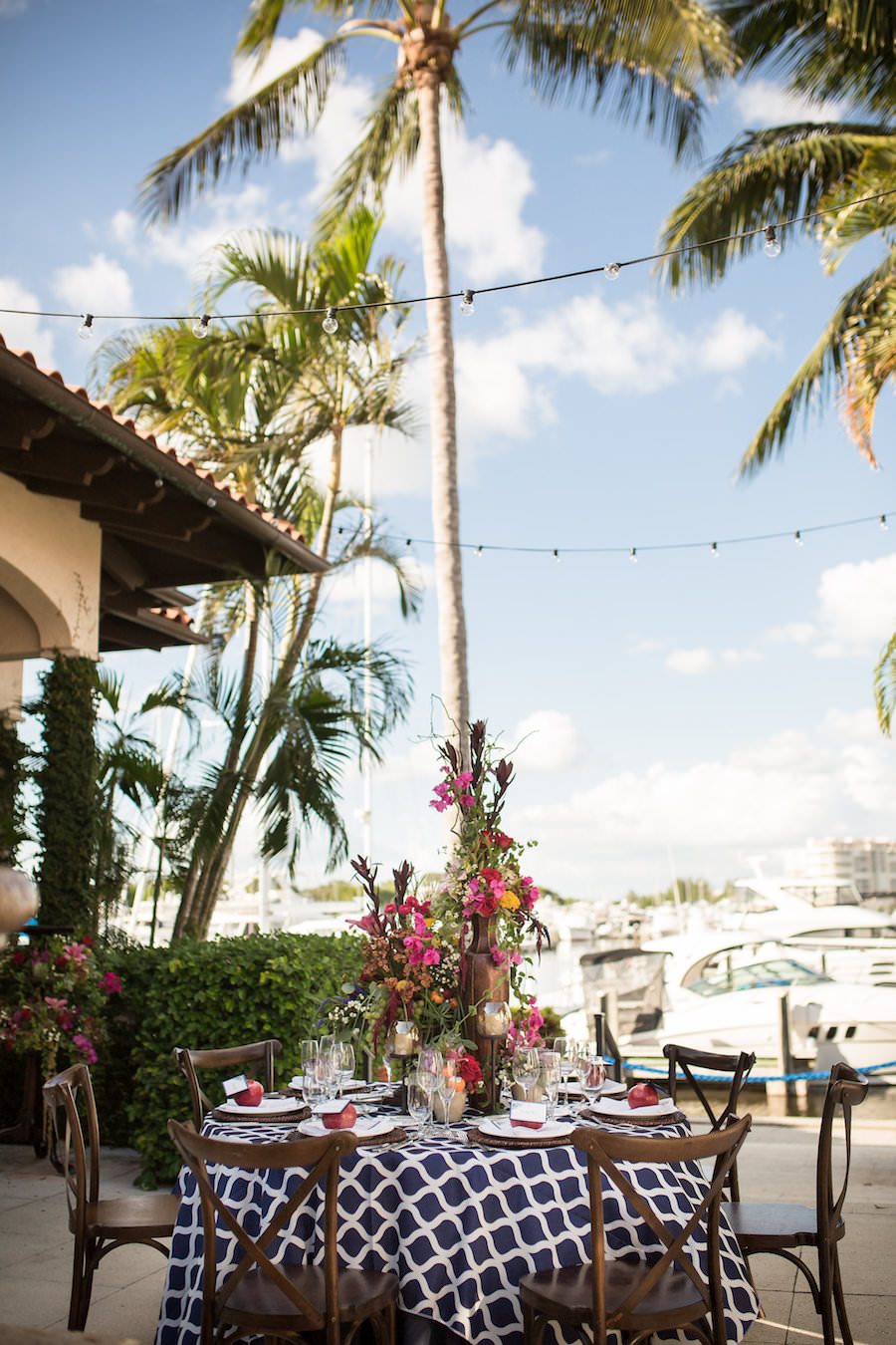 Outdoor Nautical Inspired Wedding Reception Decor with Navy Blue and White Linen and French Country Wooden Chairs | Waterfront Sarasota Wedding Venue Longboat Key Club | Sarasota Wedding Planner NK Productions