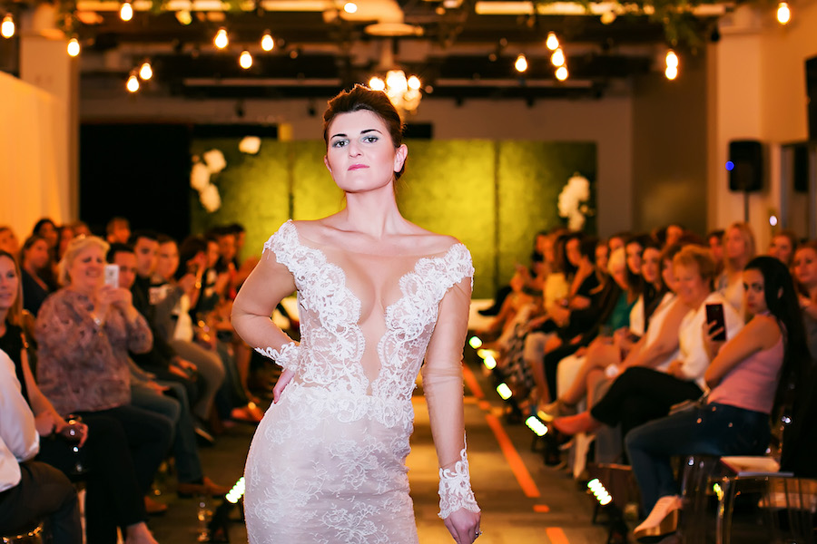 Nude Sheer Ines di Santo Low Cut Lace Wedding Dress with Sleeves | Marry Me Tampa Bay Wedding Week Bridal Fashion Runway Show | Tampa Bay Wedding Photographer Limelight Photography | Wedding Planner Glitz Events | Hair and Makeup Artist Michele Renee The Studio | Couture Wedding Dress Shop Isabel O'Neil Bridal