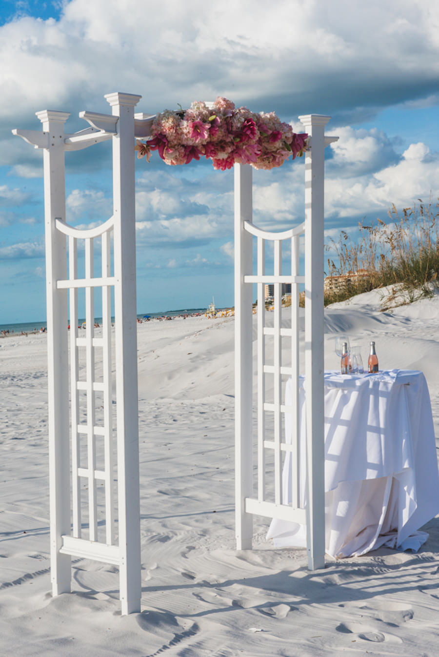 Outdoor Oceanfront Wedding Ceremony with White Arch Floral Decor with Pink and Blush Pink Flowers   Outdoor Waterfront Hotel Wedding Venue Hilton Clearwater Beach