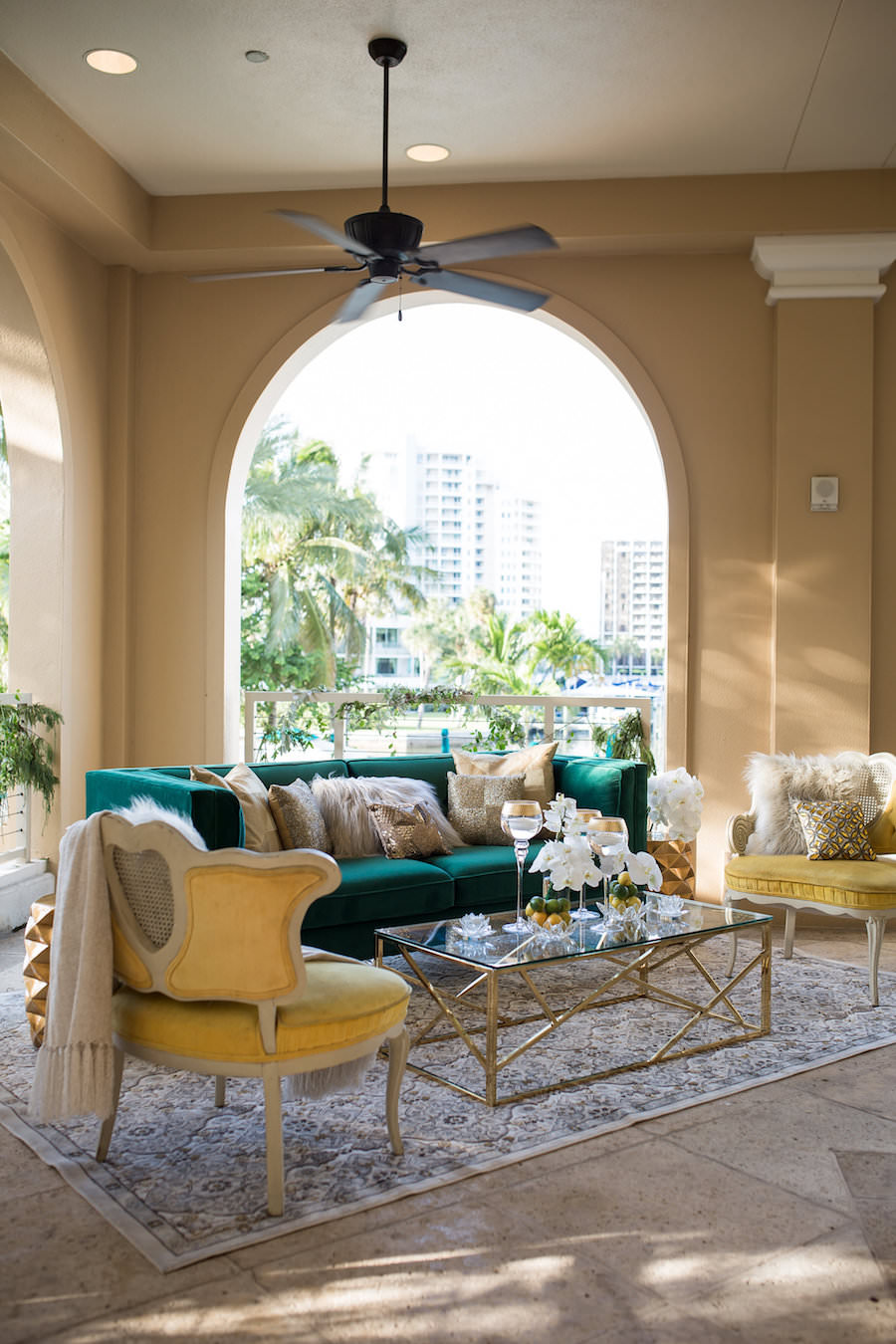 Outdoor Elegant, Sophisticated Vintage Wedding Reception Ideas & Inspiration with Mustard Yellow Vintage Chair and Emerald Green Velvet Couch | Wedding Lounge Furniture | Sarasota Wedding Planner NK Productions