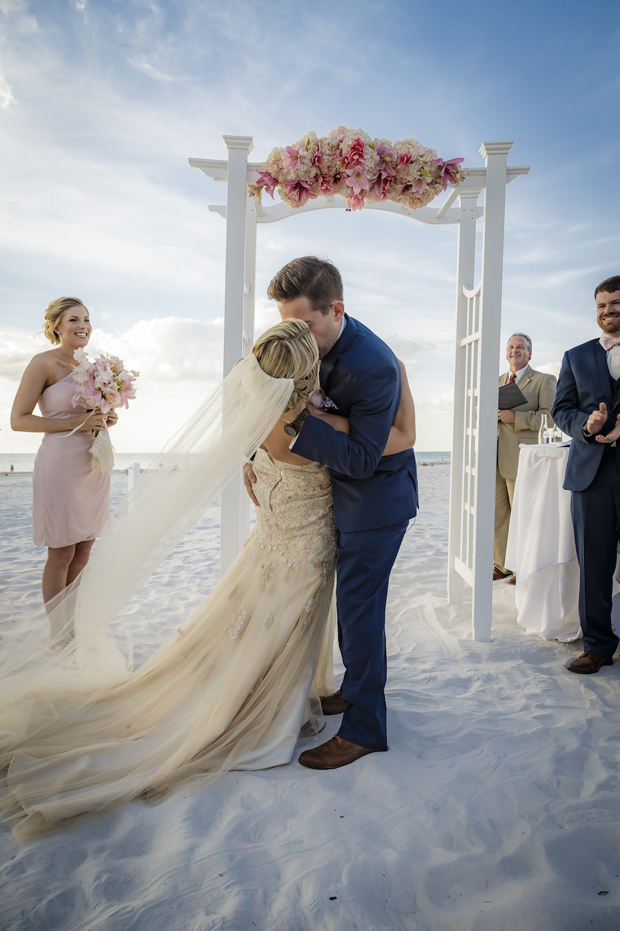 Outdoor, Tampa Bay Beach Waterfront Bride and Groom First Kiss Wedding Portrait     Outdoor Waterfront Hotel Wedding Venue Hilton Clearwater Beach