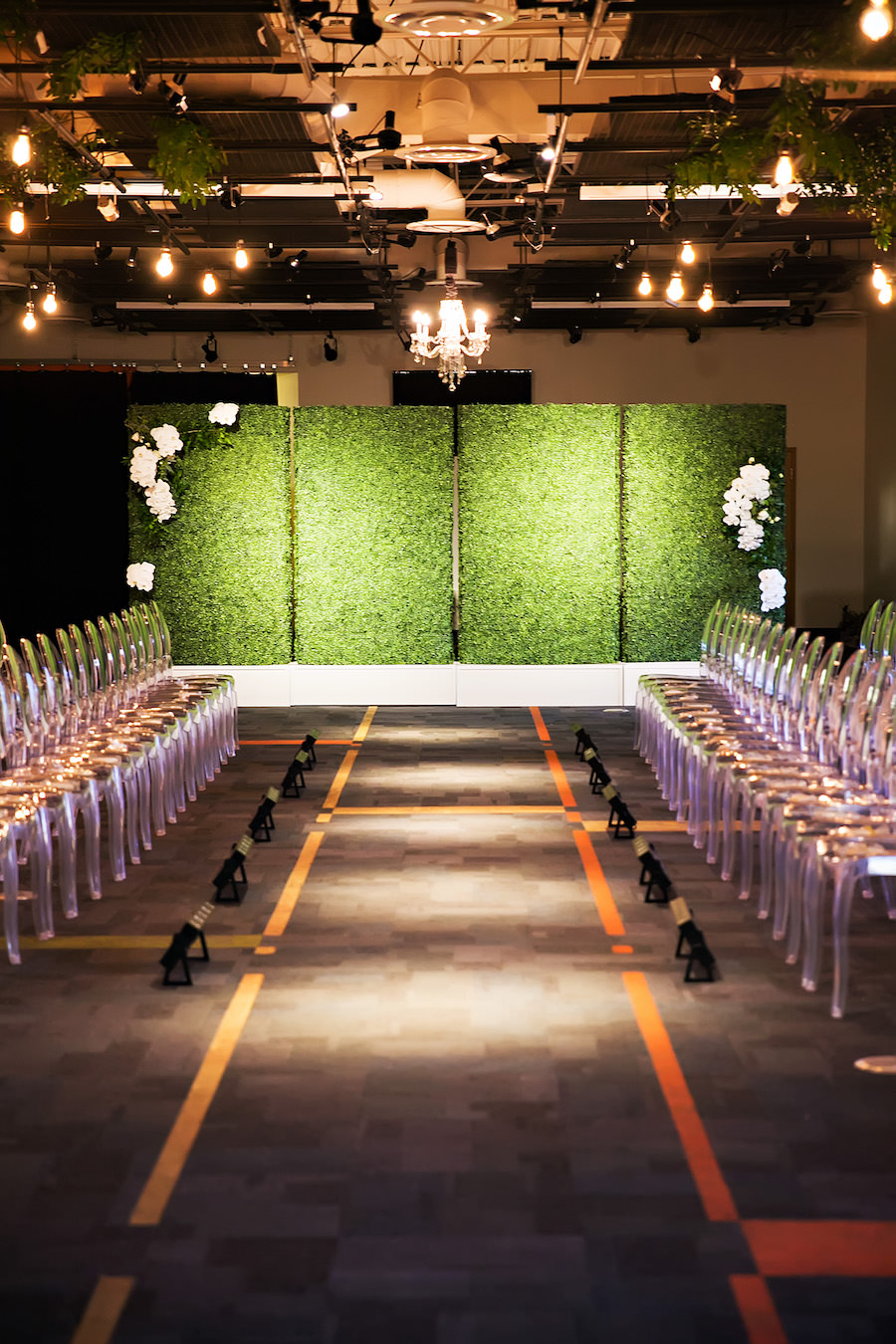 Modern Green Wedding Reception Inspiration & Ideas| Greenery Wall with Ghost Chairs and Hanging Chandeliers | Rentals A Chair Affair | Lighting Nature Coast Entertainment Services | Downtown Tampa Wedding Venue Glazer's Children Museum | Wedding Planner Glitz Events