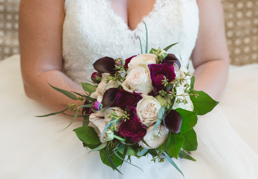 Bridal Wedding Portrait in Ivory Tulle and Lace Allure Wedding Dress with Ivory and Purple Rose Wedding Bouquet | Clearwater Beach Wedding Planning by Kimberly Hensley Events