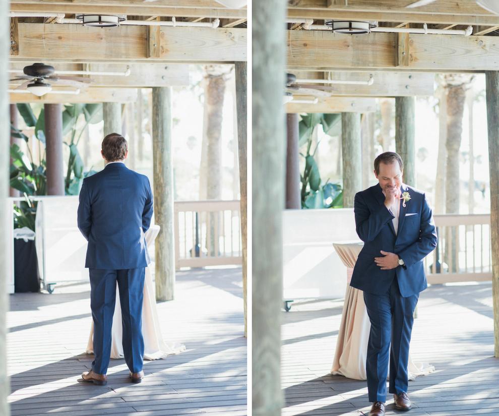 Groom in navy suit | Wedding Day first look portrait reaction