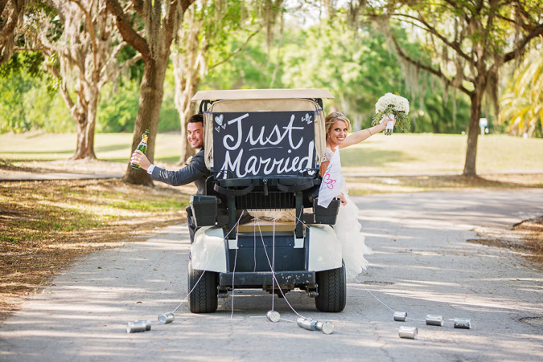 Golf Cart Wedding Exit | Bride and Groom in Just Married Golf Cart | Oldsmar Wedding Venue East Lake Woodlands Country Club