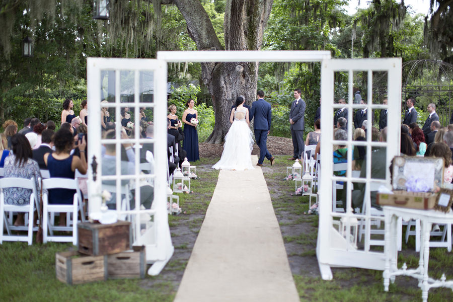 Outdoor Wedding Ceremony Under Large Oak Tree With Vintage Rustic French Doors And Crates Tampa Bay Venue Cross Creek Ranch