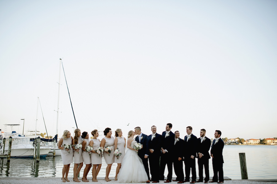 Outdoor Sarasota Bridal Party Wedding Portrait with Bride in Ivory Reem Acra Ballgown and Bridesmaids in Short Neutral Camilyn Beth Dresses   Bridal Boutique Blush Bridal Sarasota   Wedding Venue Sarasota Yacht Club   Tampa Bay Wedding Planner NK Productions