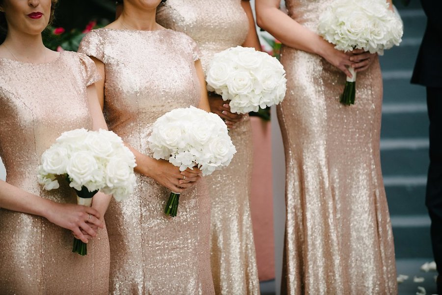 Bridesmaids in Gold Sequin Gowns with Ivory Rose Bouquets at St. Pete Beach Wedding Ceremony   St. Petersburg Wedding Venue The Don CeSar   Tampa Bay Wedding Photographer Jonathan Fanning Studio and Gallery