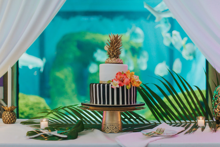 Two Tier Black And White Striped Wedding Cake With Gold Pinapple