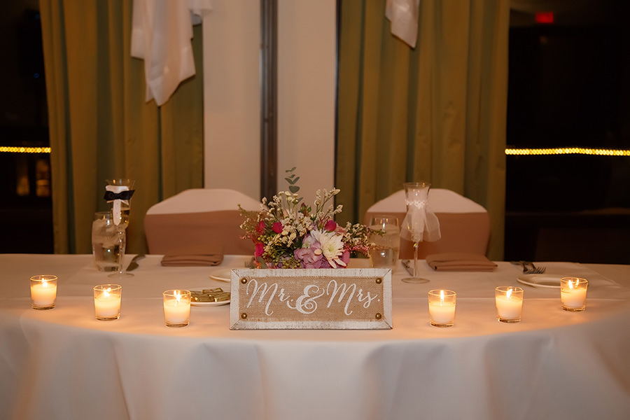 Ivory Wedding Reception Sweetheart Table With Candles Rustic Flower Arrangement And Mr Mrs Sign Decor