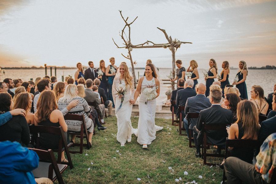 Florida Same Sex Gay Waterfront Wedding Ceremony Sunset Portrait of Brides in Ivory Wedding Dress | Tampa Wedding Photographer Rad Red Creative