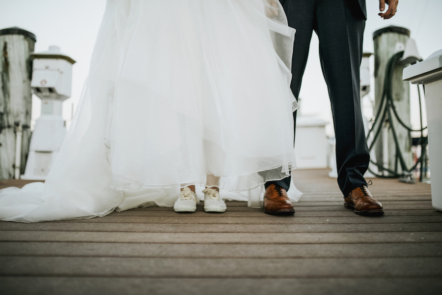 Sarasota Wedding Portrait on Boat Dock with Bride in White Sneakers and Groom in Brown Wedding Shoes   Wedding Venue Sarasota Yacht Club   Tampa Bay Wedding Planner NK Productions