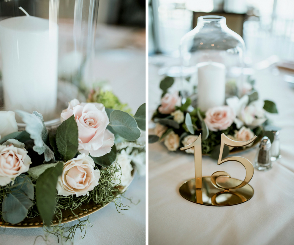 Wedding Reception Centerpieces with White Candle Surrounded by Glass Vase and Blush Roses with Greenery and Gold Table Number   Wedding Venue Sarasota Yacht Club   Tampa Bay Wedding Planner NK Productions